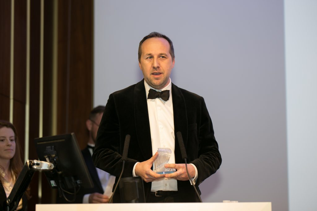 Neil Siddons, Communications Leader, GE Additive collects the 2018 3D Printing Industry Award for OEM of the year.