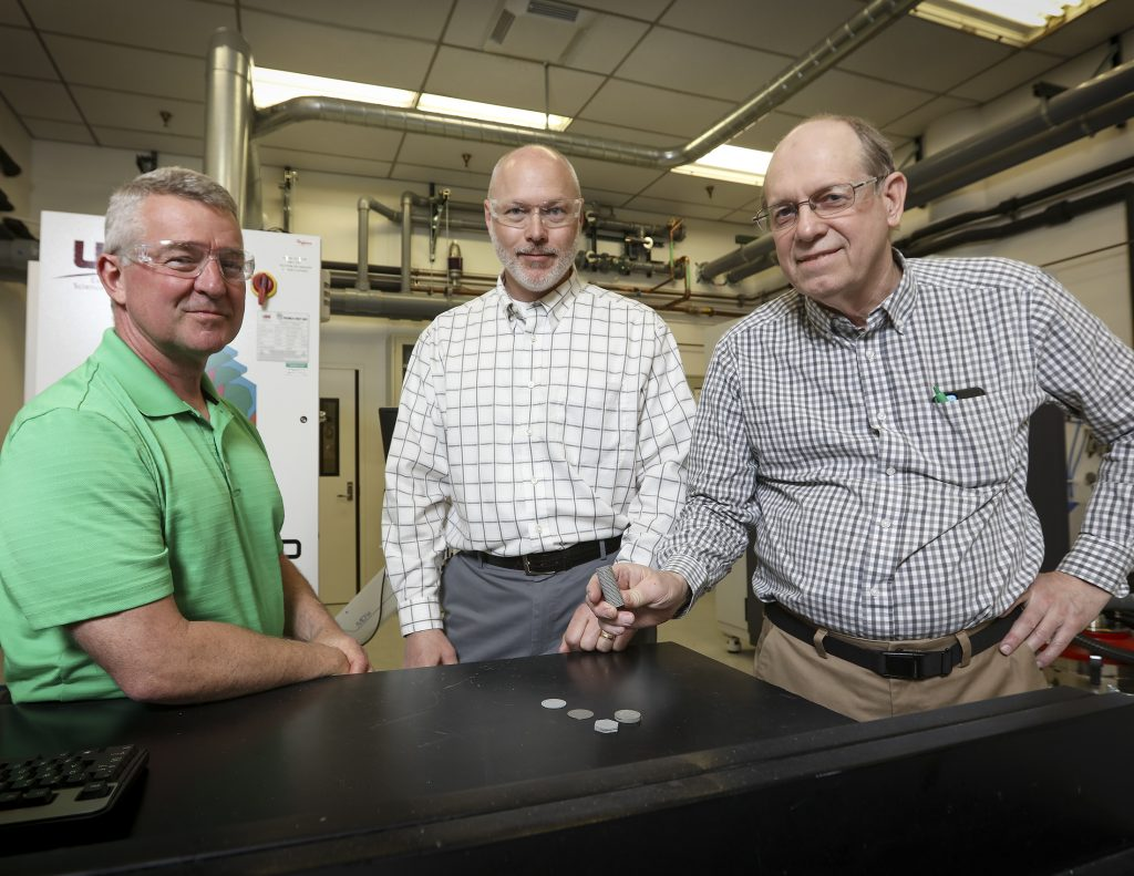 ORNL scientists Rick Lowden, Chris Bryan and Jim Kiggans with 3D printed Mo-99 discs. Photo by Jason Richards/ORNL/U.S. Dept. of Energy
