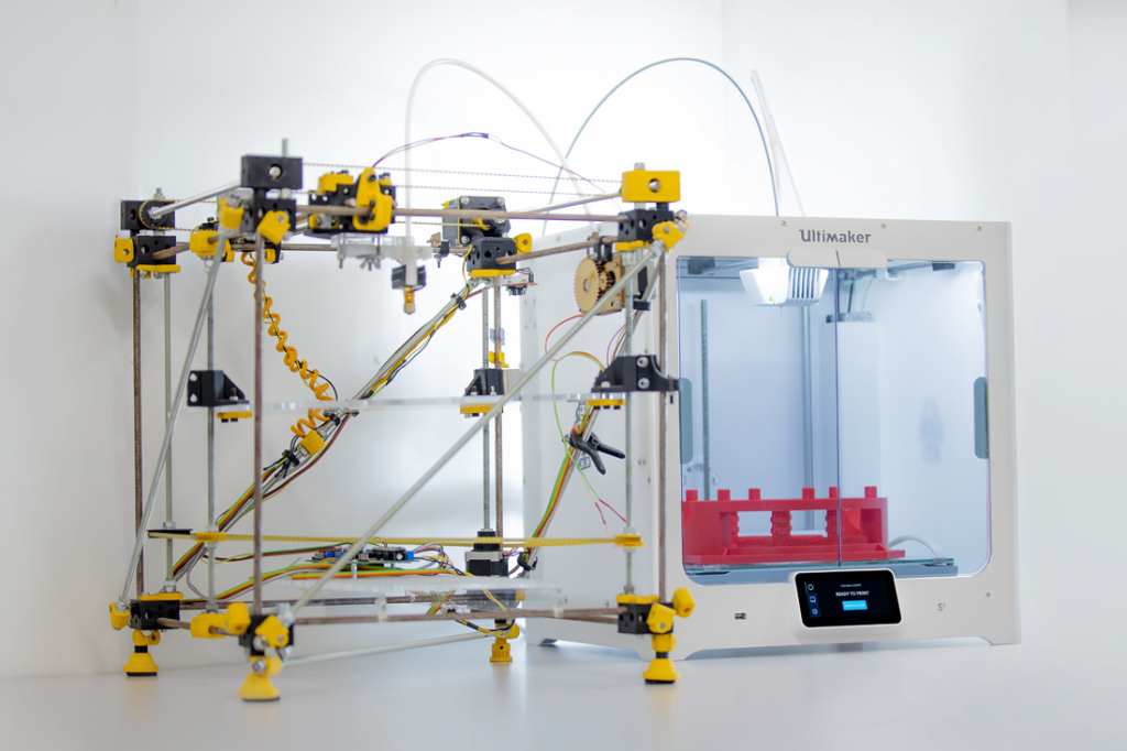 A RepRap Darwin 3D printer assembled by the co-founders of Ultimaker, pictured next to an Ultimaker S5. Photo via Ultimaker.