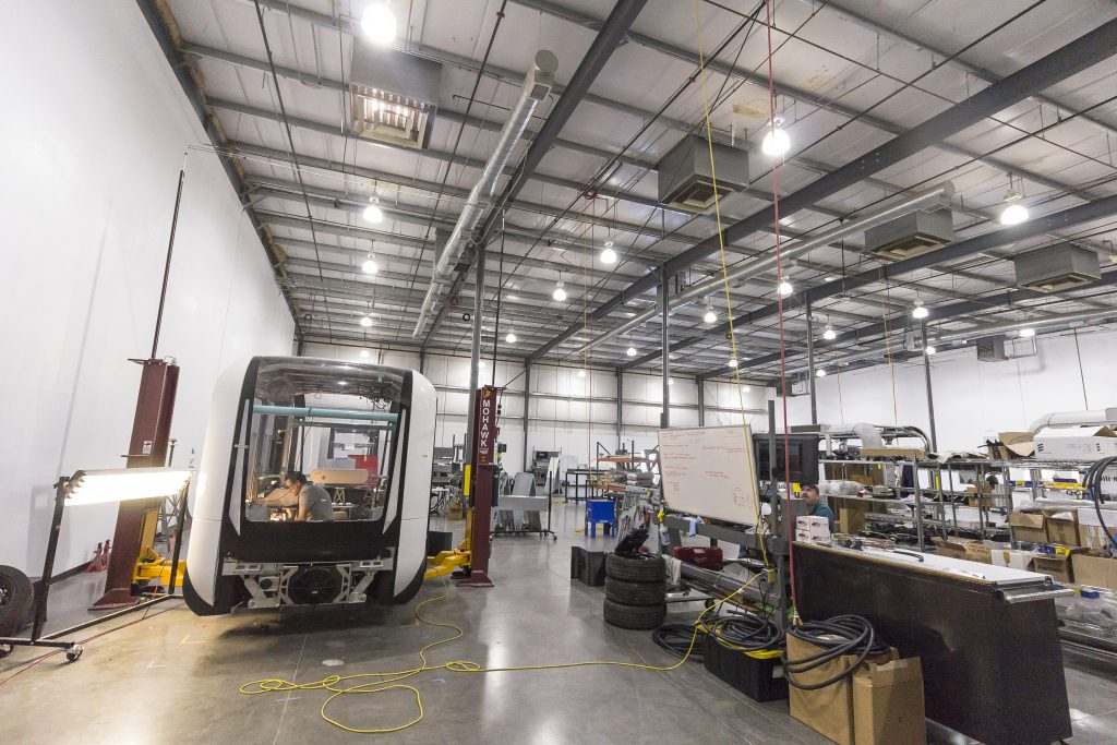 An Olli bus on the production floor in LM Industries' Arizona microfactory. Photo via LM Industries