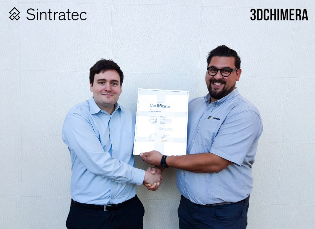 Sintratec's Dominik Solenicki and Alex Hussain of 3DChimera hold up the reseller certificate. Photo via Sintratec