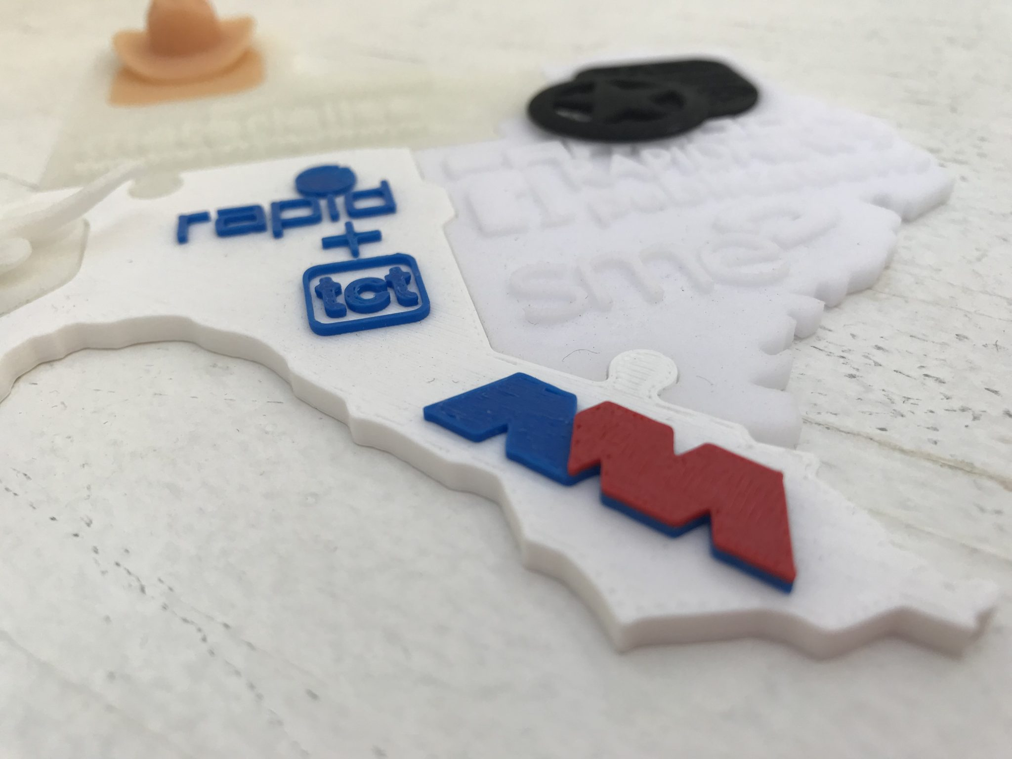 America makes logo on the 3D printed puzzle from RAPID + TCT 2018. Photo by Beau Jackson