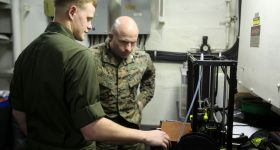 Cpl. Christopher Bigham and Col. Farrell J. Sullivan training with Building Momentum to use 3D printers. Photo via LulzBot.