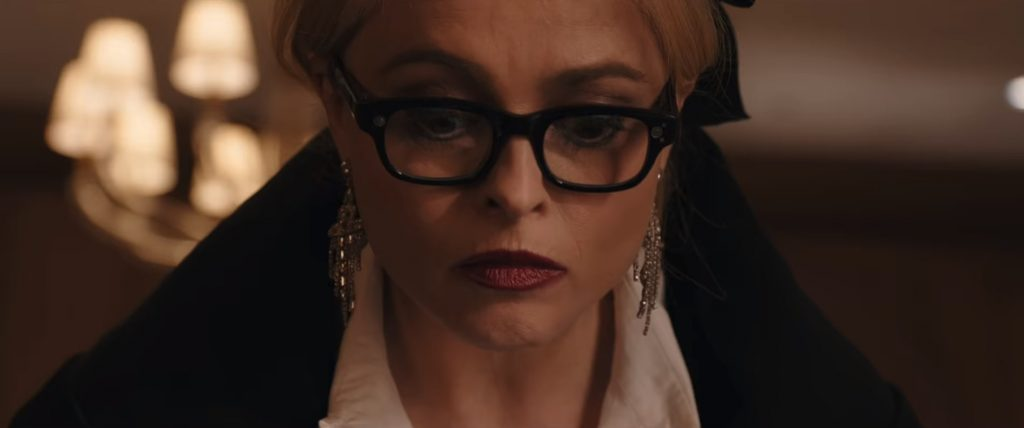 Helena Bonham Carter and her high-tech scanning specs in Ocean's 8. Image copyright Warner Bros. Entertainment Inc.