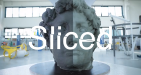 Sliced logo over a large head 3D printed on a new ceramic machine from WASP. Original image via WASP Team on YouTube
