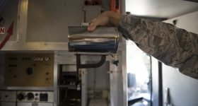 The original hot cup plastic handle. Photo via U.S. Air Force/Courtesy of Tech. Sgt. James Hodgman.