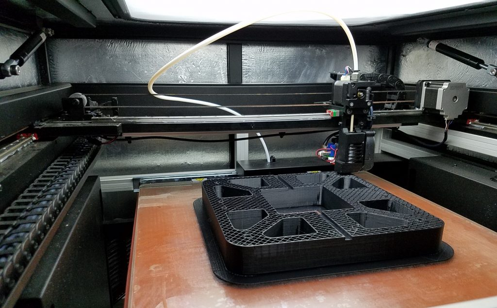 3D printing a fixture. Photo via INTAMSYS.