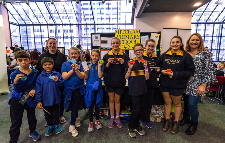 Students from Mitcham Primary School holding up their 3D printing inventions. Photo via Makers Empire.