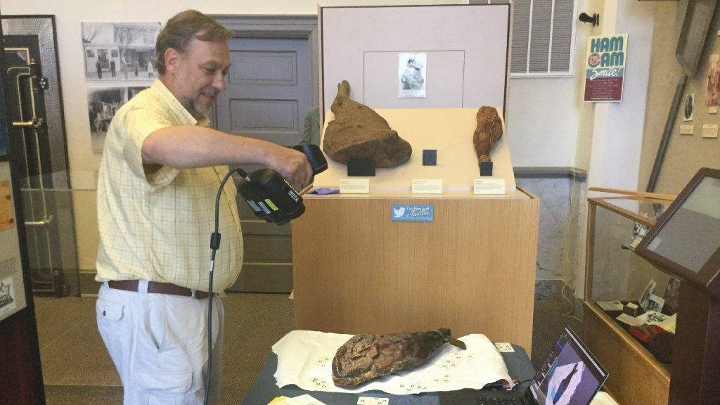 Virginia Commonwealth University professor Bernard Means scans the world's oldest ham in Smithfield. Photo via Daily Press/Courtesy of Bernard Means.