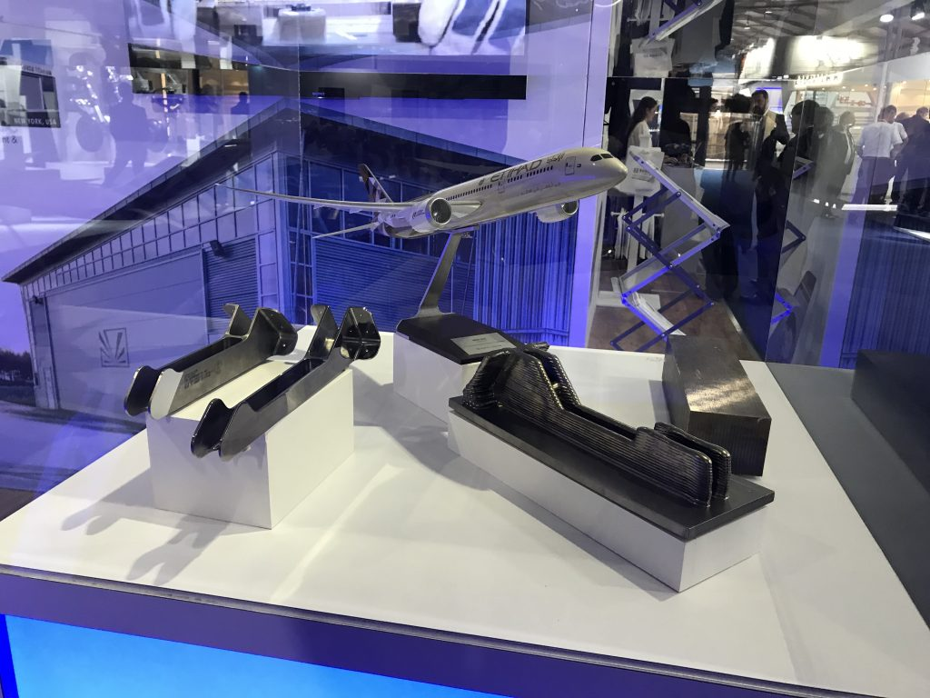 Norsk Titanium 3D printed aft galley brackets on display at Farnborough Airshow 2018. Photo by Beau Jackson