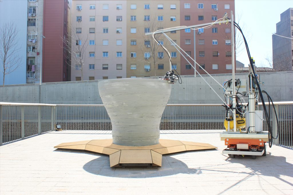 "One ""Minibuilder"" robot 3D prints a large scale vase. Photo via IAAC"