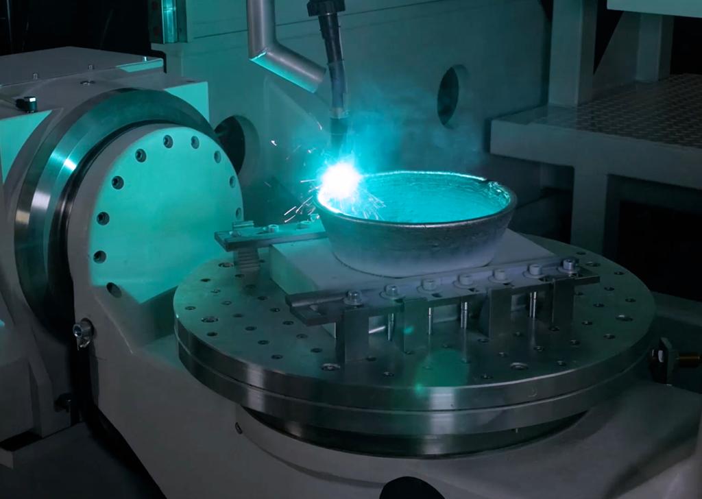 Inside a 3DMP 3D printer. Photo via GEFERTEC