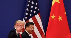 U.S. President Donald Trump waves next to Chinese President Xi Jinping