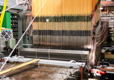 HEEET material for future missions will be woven with a new 24-inch loom that is capable of weaving dual layer HEEET material 24 inches wide at thicknesses of 2 inches and greater. Photo via NASA.