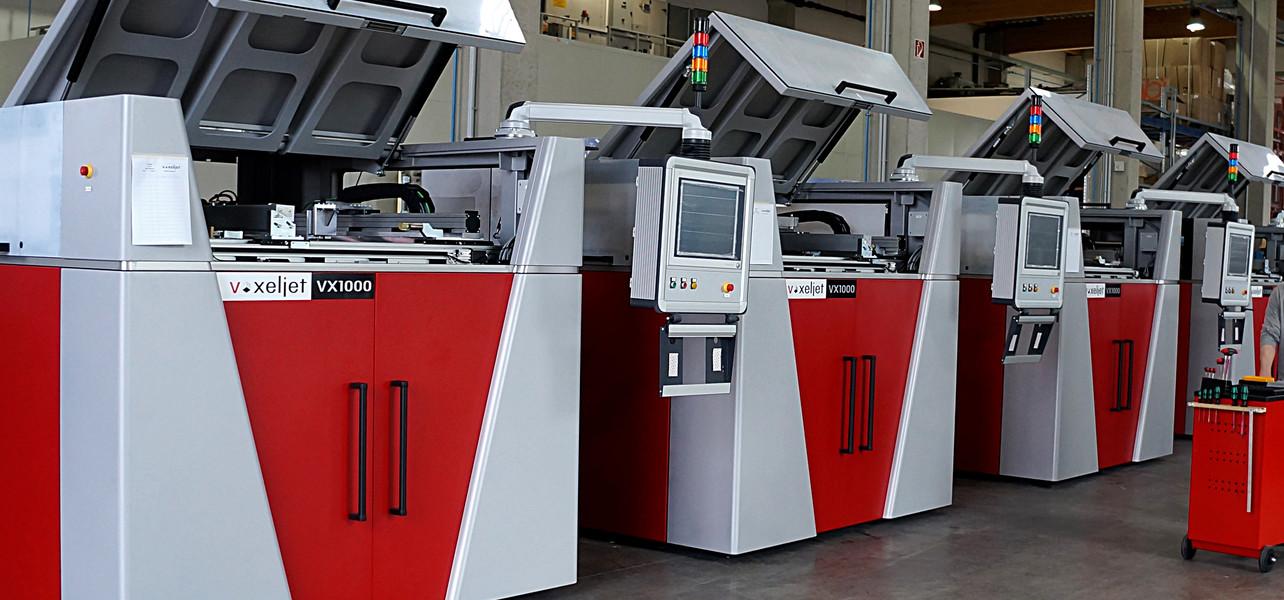 Line of voxeljet VX1000 3D printers. Photo via voxeljet