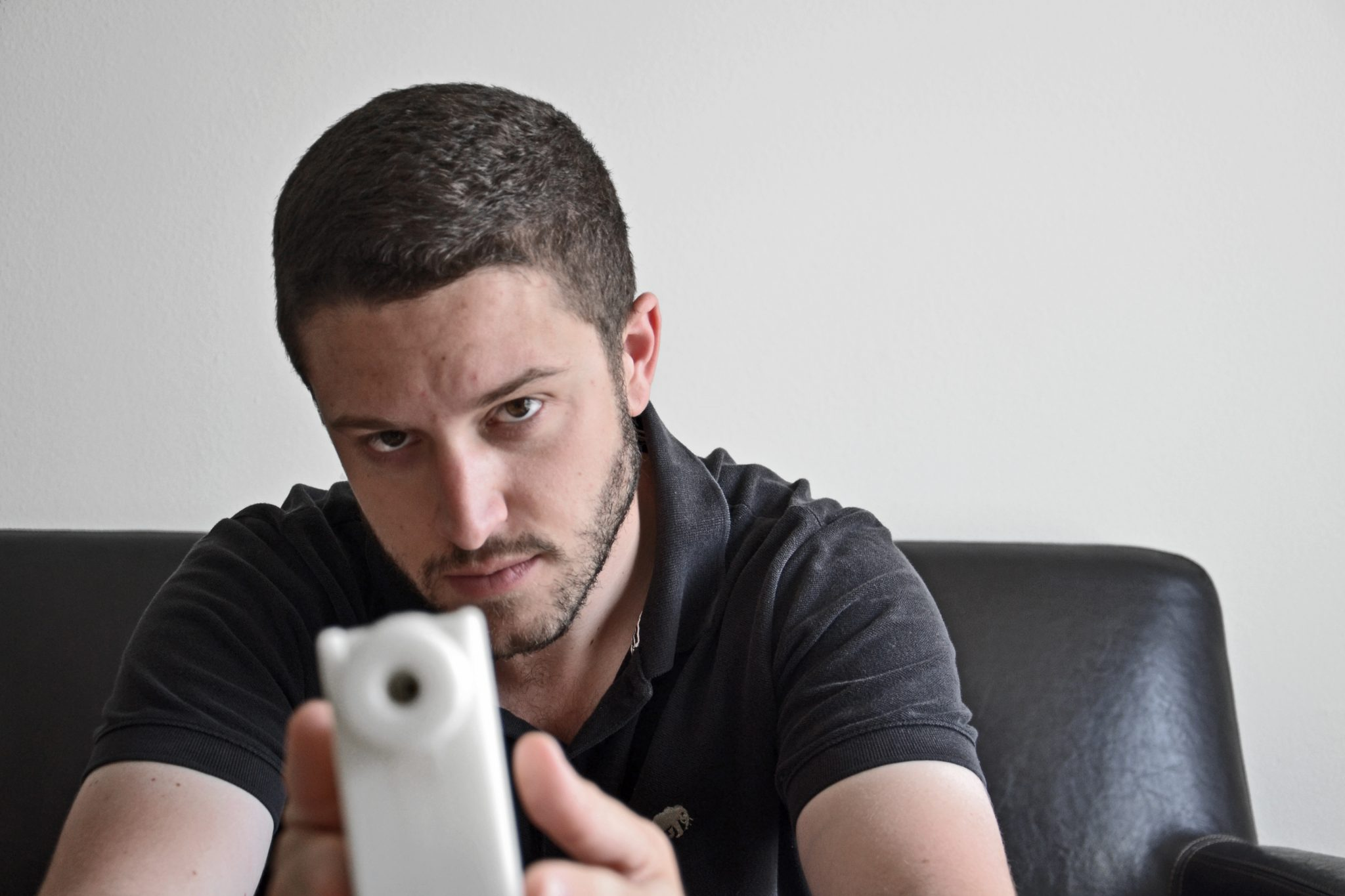 Defense Distributed founder Cody Wilson holds the 3D printed Plastic Liberator. Photo by Lorenza Baroncelli