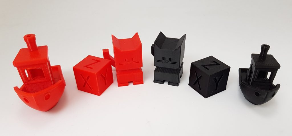 Calibration 3D prints of Amazon Basics red PETG and black PLA. Photo by 3D Printing Industry