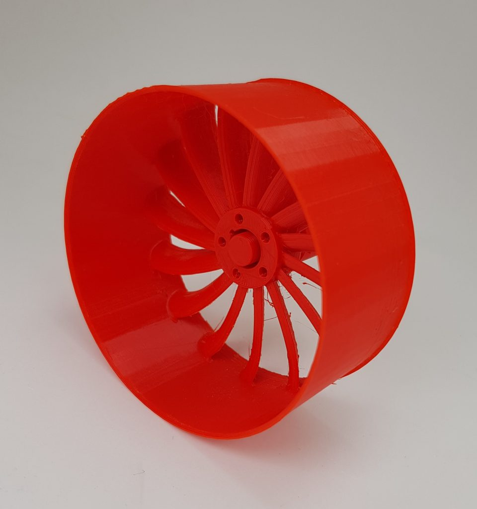 A wheel made from Amazon Basics red PETG filament. Photo by 3D Printing Industry