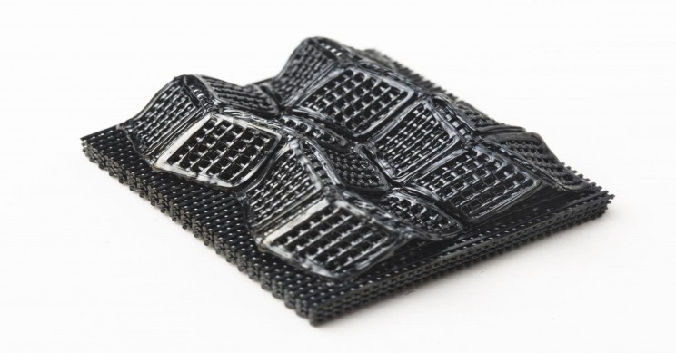 4D-printed ceramic folding flat surface known as a Miura-ori. Photo via CityU.