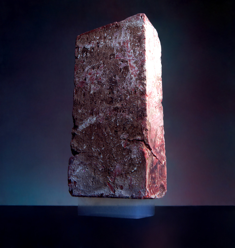 A 2.5 kg brick is supported by an aerogel with a mass of 2 g. Photo via NASA/JPL-Caltech