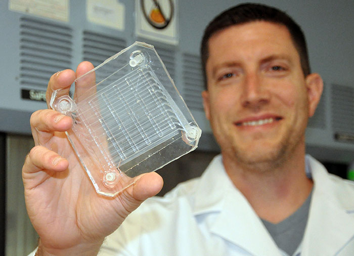 Biomedical engineer Dr. Joseph Potkay, with the VA Ann Arbor Health Care System, displays a 2D prototype of an artificial lung. A 3D version is in production. Photo by Brian Hayes/VA