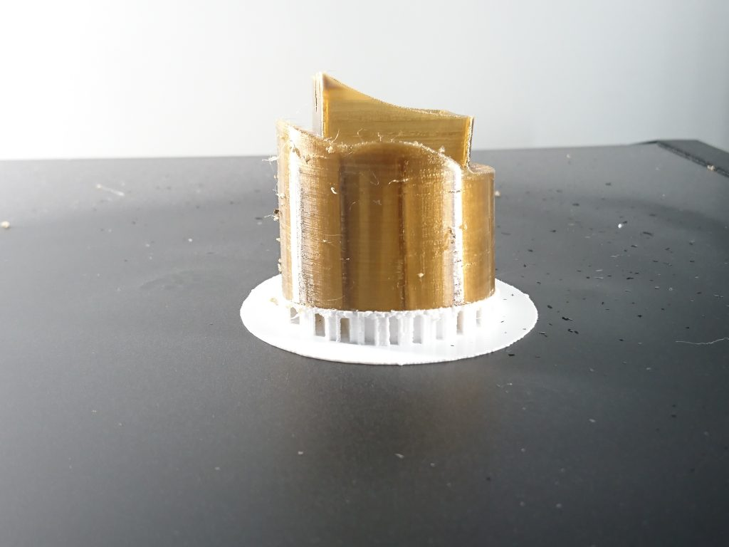 PEEK filament test along with breakaway support. Photo by 3D Printing Industry.