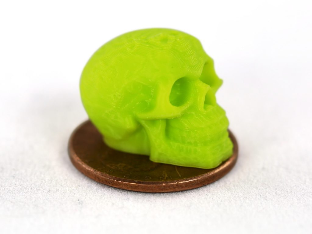 A penny-sized skull printed using the new Aerostruder v2 Micro Tool Head. Photo via Aleph Objects.