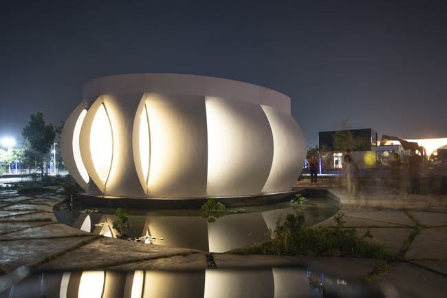 An evening view of the Lotus House following its completion at the Dezhou, China site. Photo via WashU.