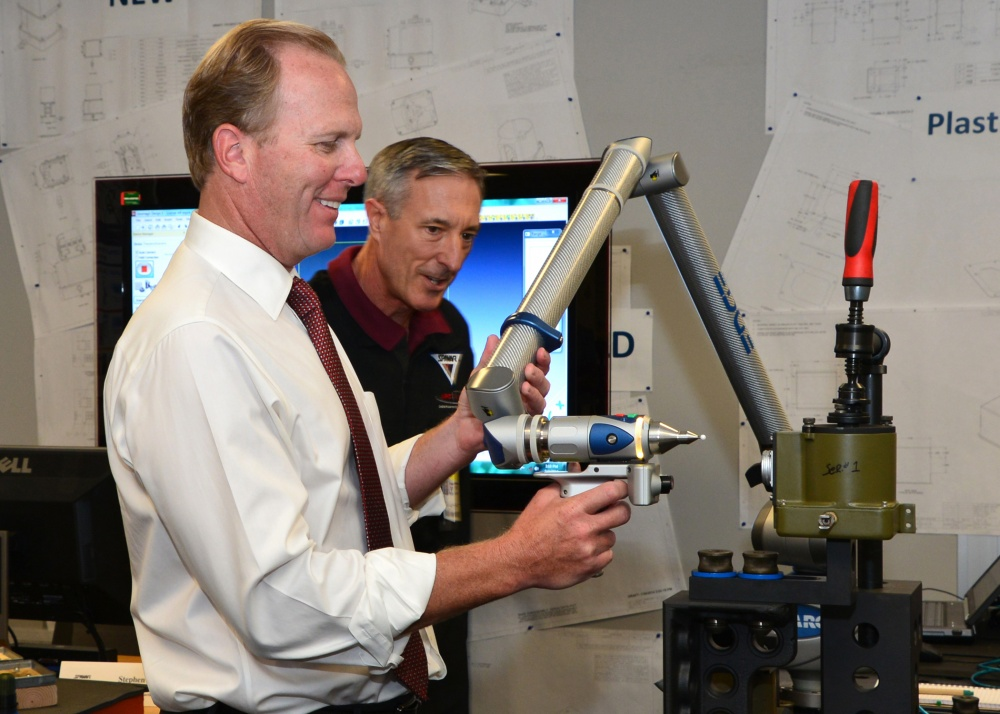 San Diego Mayor Kevin Faulconer tries his hand at 3D mapping under the supervision of Cox. Photo via Rick Naystatt/SPAWAR.