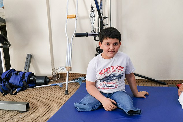 Abdel Basit lost both his legs in the Syrian conflict. Photo via Daily Mail