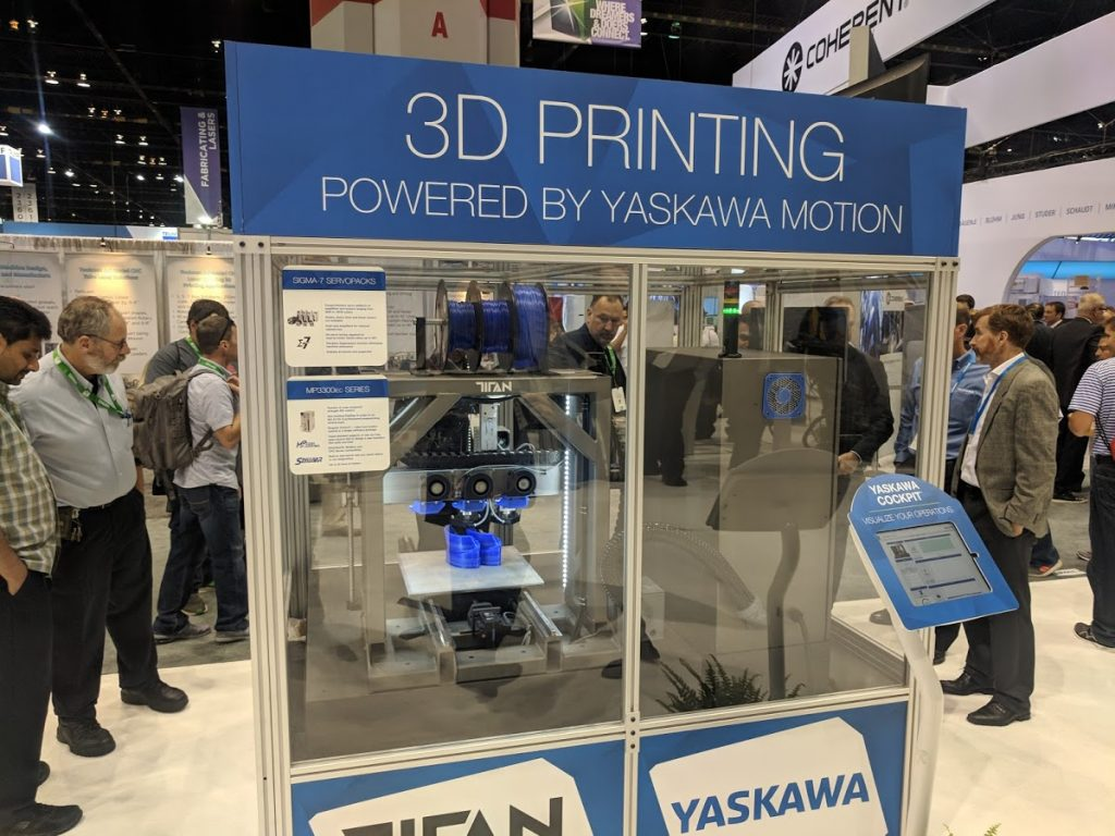A 3D printing robot by Titan Robotics and Yaskawa at IMTS 2018. Photo by Michael Petch.