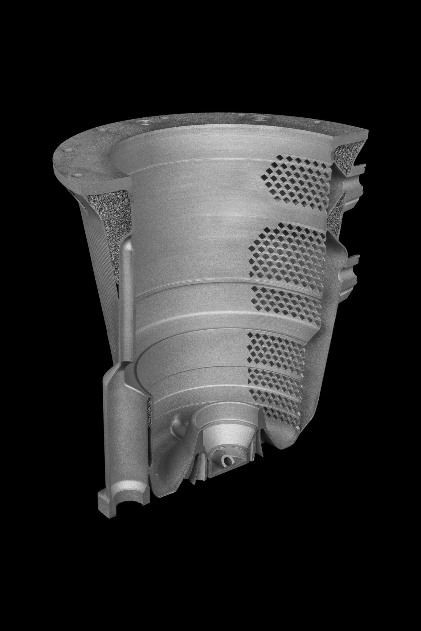 The redesigned electrical generator housing which includes integrated lattice structures. Clip via Betatype.