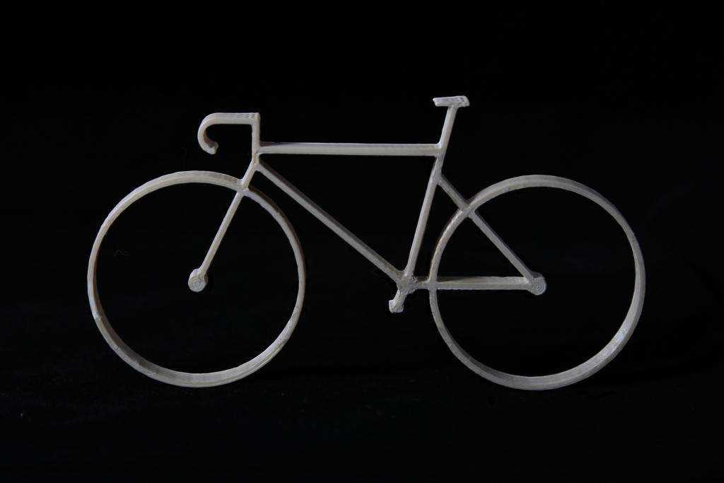 A miniature bike frame 3D printed using the lab's LCP material. Photo via ETH Zürich.