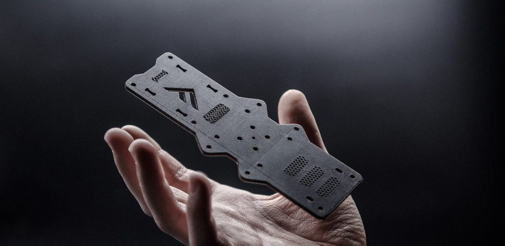 Flexprint 3D printed carbon fiber part for aerospace. Photo via Fortify