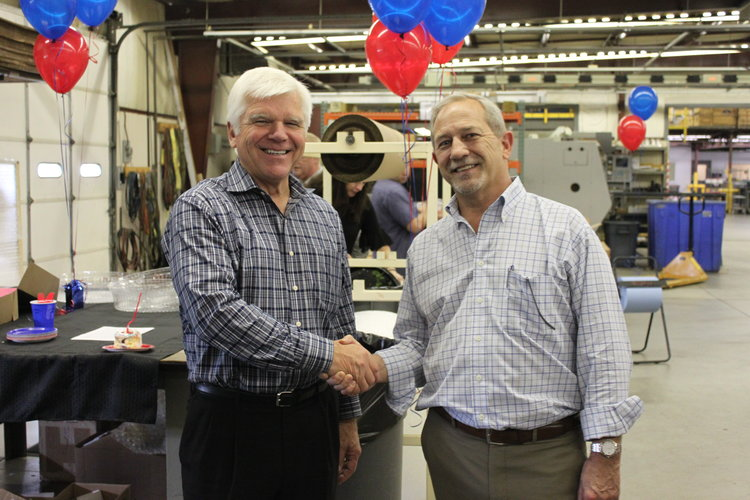 Left: John Barneson Senior Vice President of Corporate Development at Kaiser Aluminum Corporation, shakes hands with Chris Joest (Right), President of Imperial Machine & Tool Co. Photo via Imperial Machine & Tool Co.
