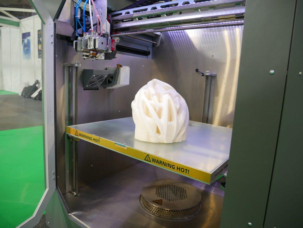 A 3D printed helmet inside the Factory 2.0. Photo by Tia Vialva.