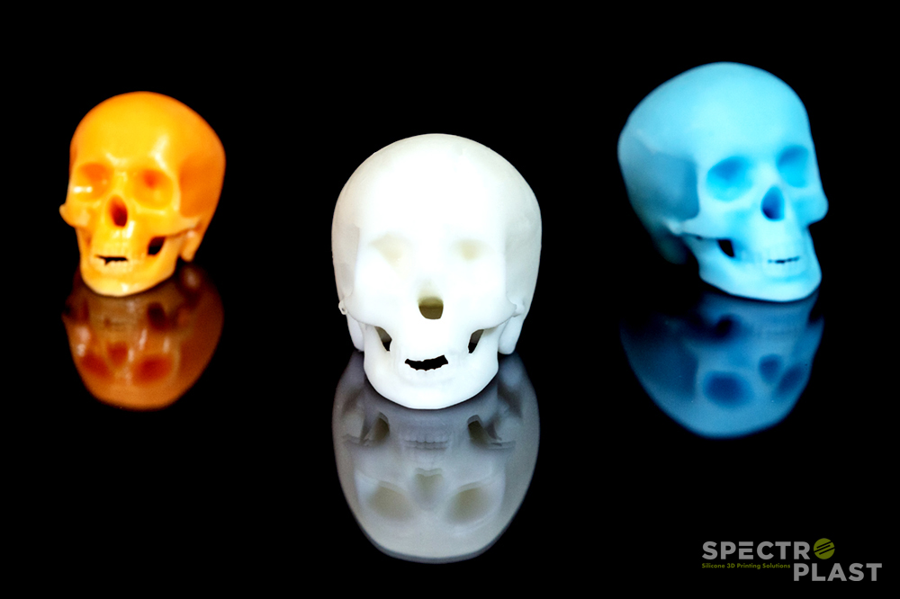 Colored, 3D printed skulls. Photo via Spectroplast