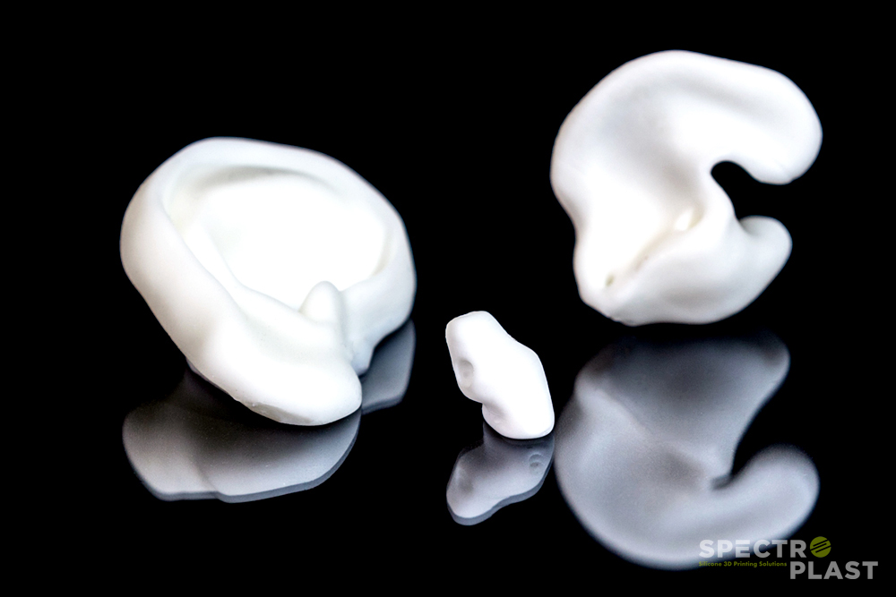Silicone 3D printed hearing aid/ear models. Photo via Spectroplast