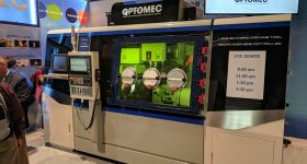 The Optomec LENS 860 closed atmosphere hybrid additive manufacturing system. Photo by Michael Petch.