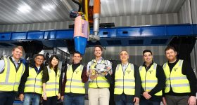 The Titomic and TAUV team with the 3D printed titanium UAV. Photo via Titomic.
