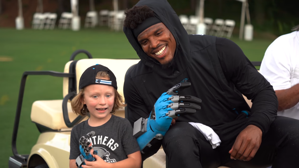 Cameron Haight and his hero, Carolina Panthers quarterback, Cam Newton. Photo via Riot Report