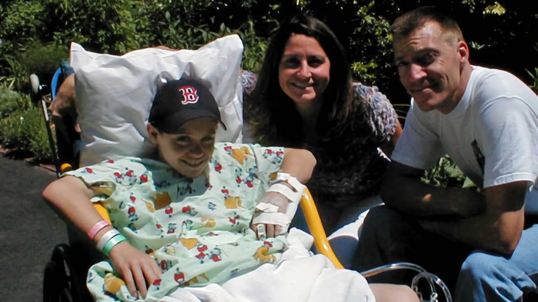 Luke Massella, aged 10 in 2001 with his mother and uncle after numerous surgeries. Photo via BBC News.