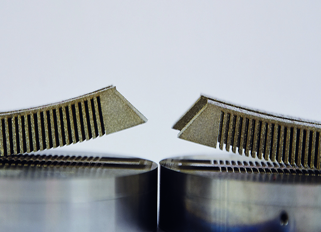 Distortion on LPBF 3D printed Inconel competent heated only from below (left) versus the same Inconel component made when heated from above and below (right). Photo via Fraunhofer ILT
