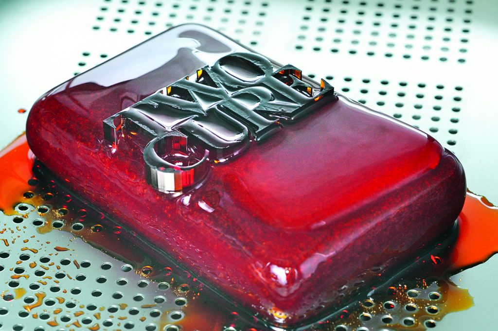 A TwoCure 3D printed component emerges from its waxy block. Photo via Fraunhofer ILT