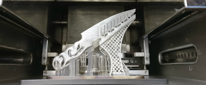 Stuart Mitchell's 3D printed knife still on the build platform. Photo via the University of Sheffield AMRC.