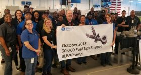 Employees of GE Aviation Auburn celebrate the delivery of the 30,000th 3D printed fuel tip. Photo via GE Aviation
