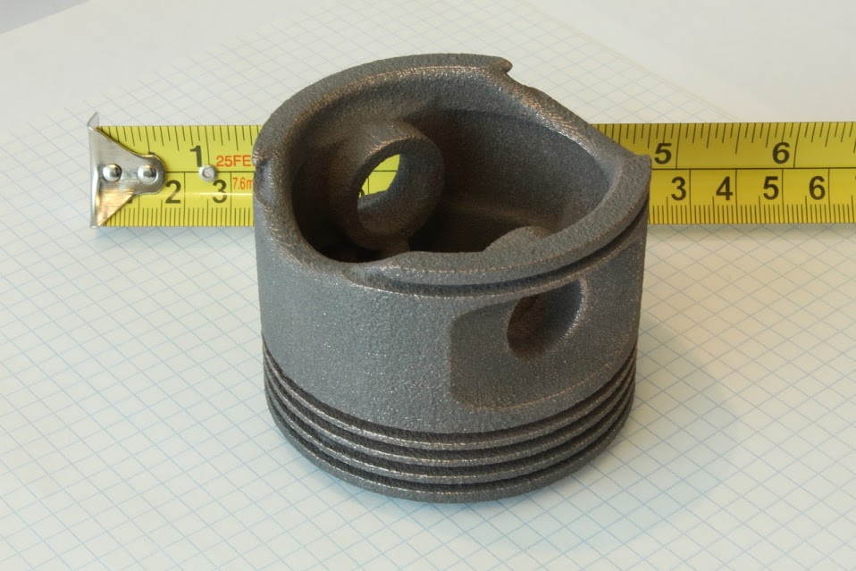 Copper iron piston 3D printed by iro3d. Photo via iro3d