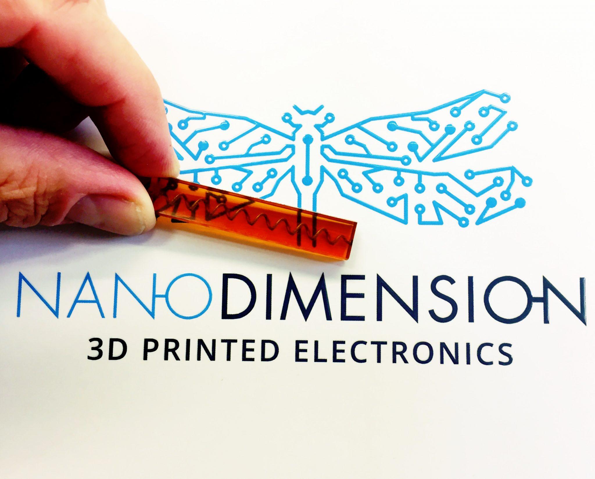 3D printed conductive spiral within a non-planar component. Photo via Nano Dimension