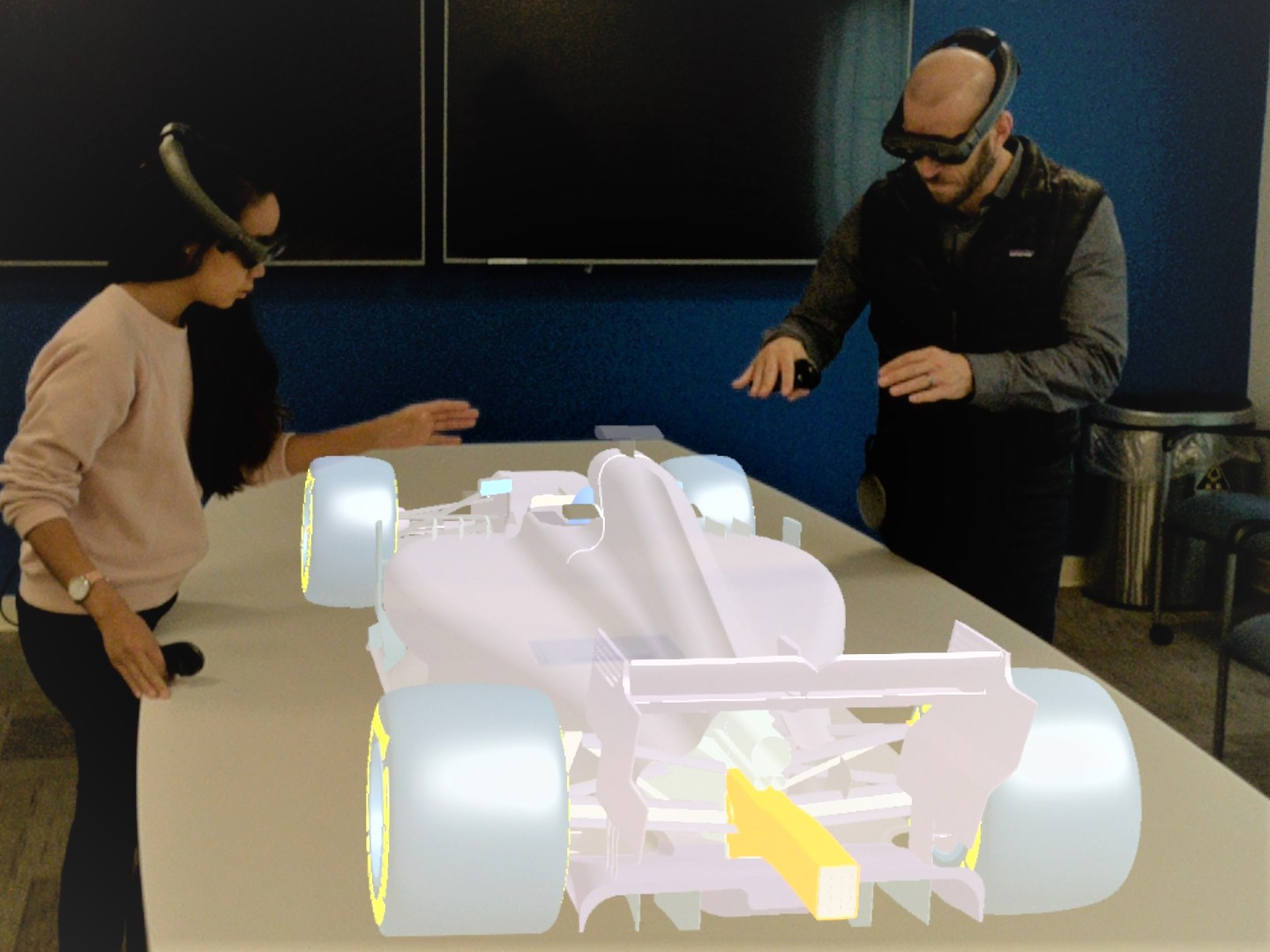 Onshape engineers testing out the new app with a Formula One car designed by an Onshape customer, Team Perrinn. Image via Magic Leap.
