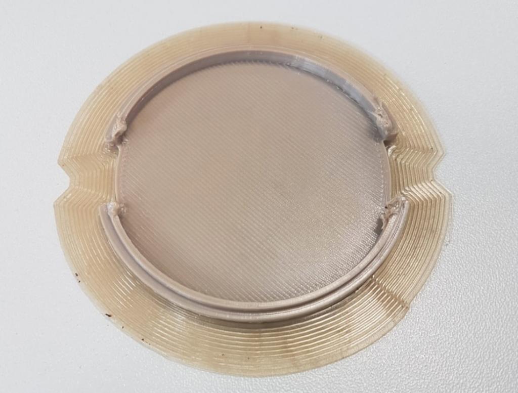 Camera lens cap 3D printed in PEEK using Direct Print settings.